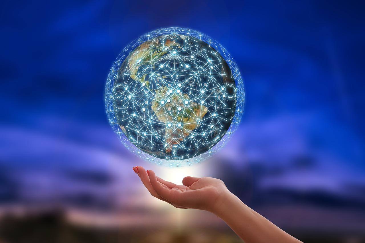 Weltkugel mit symbolisiertem Netzwerk, Hand